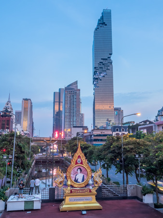 BANGKOK - AUGUST 28: Mahanakorn skyscraper building, the tallest building in Thailand, along street under twilight evening sky in Bangkok, Thailand, on August 28, 2016. Editorial