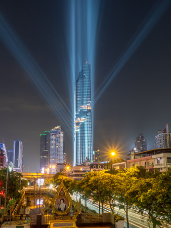 BANGKOK - AUGUST 28: Mahanakorn skyscraper building, the tallest building in Thailand, in grand opening rehearsal light show under twilight evening sky in Bangkok, Thailand, on August 28, 2016. Editorial
