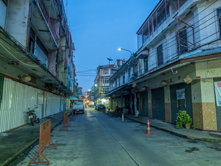 abandon: BANGKOK - SEPTEMBER 20: Woeng Nakorn Kasem, the old town music shop arcade, was evicted from new owner, abandoned building under twilight mood, Bangkok, Thailand, on September 20, 2016.
