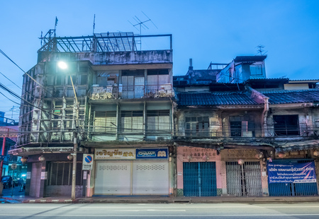eviction: BANGKOK - SEPTEMBER 20: Woeng Nakorn Kasem, the old town music shop arcade, was evicted from new owner, abandoned building under twilight mood, Bangkok, Thailand, on September 20, 2016.