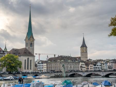 ZURICH - OCTOBER 8: Landmark viewpoint of Zurich, Two towers of Fraumunster and Saint Peter church, under cloudy sky in Zurich, Switzerland, on October 8, 2016.