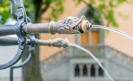 Water flow through art fountain tap in Lindenhof park in Zurich, Switzerland Stock Photo