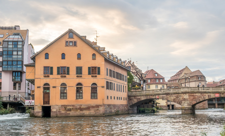 unrecognized: The quarters weirs and half-timbered buildings with unrecognized tourists in Petite France area in Strasbourg, France Editorial