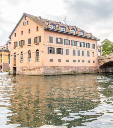 quarters: The quarters weirs and half-timbered buildings with unrecognized tourists in Petite France area in Strasbourg, France Editorial
