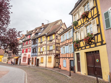 way of living: COLMAR - OCTOBER 9: Unique peaceful town and buildings in Colmar, known as little Venice, under cloudy sky in France, on October 9, 2016.