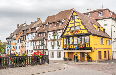 COLMAR - OCTOBER 9: Unique peaceful town and buildings in Colmar, known as little Venice, under cloudy sky in France, on October 9, 2016.
