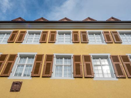 freiburg: Windows of Yellow building in Freiburg, Germany Stock Photo