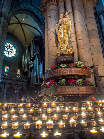 freiburg: FREIBURG - OCTOBER 10: Saint sculpture inside of Freiburg Minster cathedral with pray candles in Freiburg, Germany, on October 10, 2016.