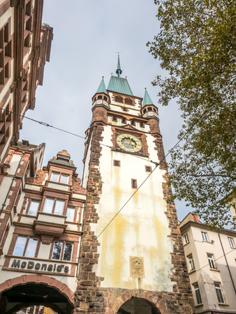 FREIBURG - OCTOBER 10: Freiburg historical buildings with clock tower under cloudy sky in Freiburg, Germany, on October 10, 2016.