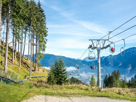 OBERAMMERGAU - OCTOBER 13: Kolben chair lift with cable structures in Kolbensattel mountain in Oberammergau, Germany, on October 13, 2016.