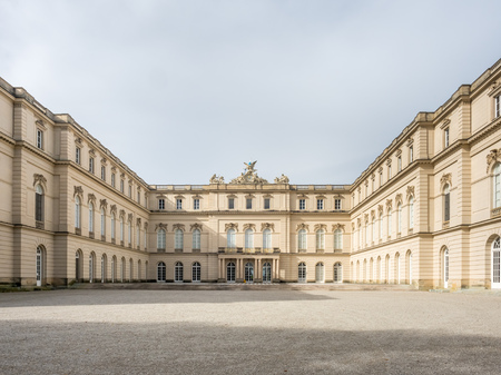 Herrenchiemsee palace and surrounding park under cloudy sky in Germany
