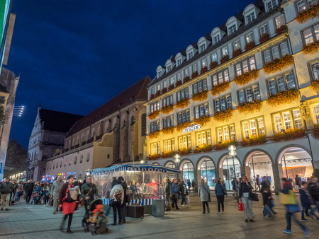 MUNICH - OCTOBER 14 : Hirmer shop building on Kaufinger street under twilight evening sky in Munich, Germany, on October 14, 2016. Editorial