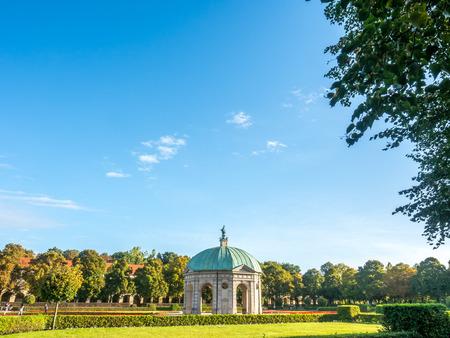 residenz: Palace garden, Hofgarten, near Munich Residenz, is place for rest in Munich under morning clear blue sky, Germany Stock Photo