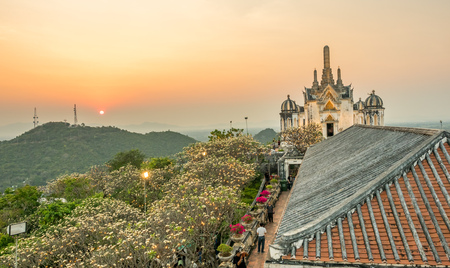 Phra Nakorn Kiri (Palace on the hill) is landmark of Petchaburi city in Thailand with old classic historic buildings, under evening sky, with some unrecognized toursits