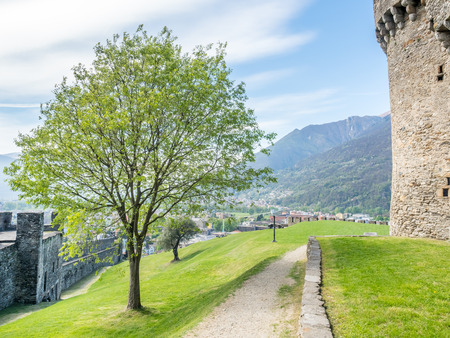 Castello di Montebello in Bellinzona city in Switzerland, surrounding with mountain, forests and impressive landscape view, under cloudy blue sky Editorial