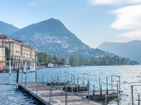 Natural view scene around Lake Lugano, mountain and cloudy blue sky in Switzerland