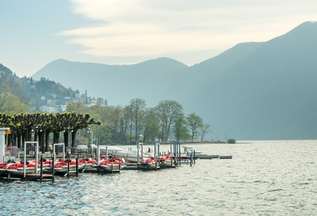 LUGANO - APRIL 7 : Natural scenic view around Lake Lugano under cloudy blue sky in Lugano, Switzerland , on April 7, 2017.