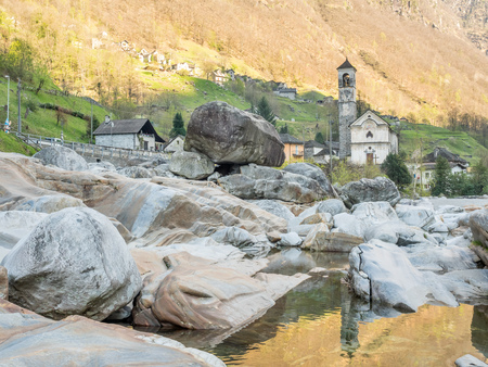 angeli: The Parish church of Madonna degli Angeli along Vercasca river with water reflection in Lavertezzo city, Switzerland, one of the landmark of Locarno Stock Photo