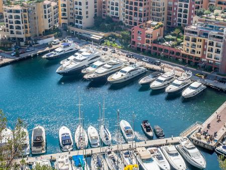 MONACO - APRIL 8 : Scene view around yacht harbor and skyscraper buildings in Monaco, Monaco, on April 8, 2017.