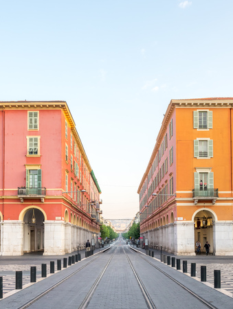 NICE - APRIL 9 : Red ochre Italian style buildings at Massena square, main center of city, in Nice, France, on April 9, 2017.