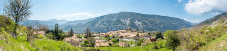 Panoramic view of The Gréolières village on plateau among mountains in France, scenic viewpoint landmark of road trip in France