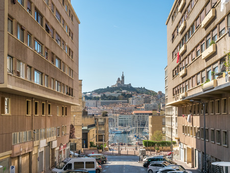 MARKSEILLE - APRIL 11 : View of old port of Marseille and Basilica of Our Lady of Guard catholic church (Notre-Dame de la Garde) from street to the port in Marseille, France, on April 11, 2017. Editorial