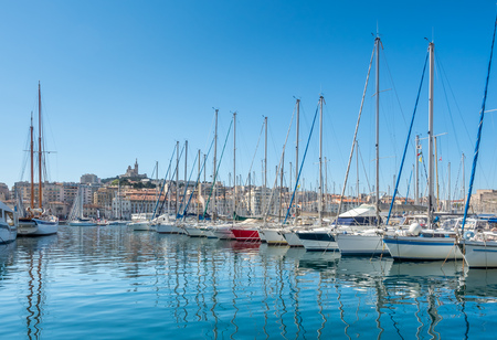 navy pier: MARSEILLE - APRIL 11 : Old port of Marseille with Basilica of Our Lady of the Guard catholic church in background, crowded with luxury yachts, in Marseille, France, on April 11, 2017. Editorial