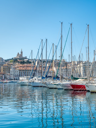 MARSEILLE - APRIL 11 : Old port of Marseille with Basilica of Our Lady of the Guard catholic church in background, crowded with luxury yachts, in Marseille, France, on April 11, 2017. Editorial