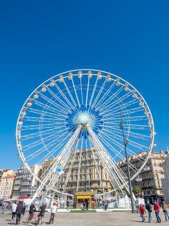 play the old park: MARSEILLE - APRIL 11 : Large Ferris wheel at square of old port of Marseille, France, on April 11, 2017.