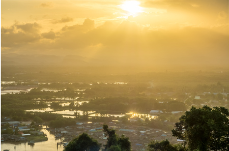 brackish water: Twilight evening sunray with reflection from brackish water in Chumphon estuary town, Thailand Stock Photo
