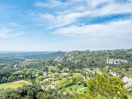 Landscape view of cultivated field from Chateau des Baux-de-provence in France under cloudy blue sky Stok Fotoğraf