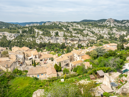 Village of Les Baux-de-provence amoung rocky mountain, view from Hares Burrow, in France