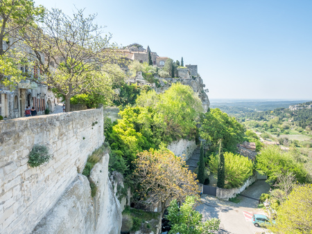 Stone architecture in village of Les Baux-de-provence in France under cloudy blue sky