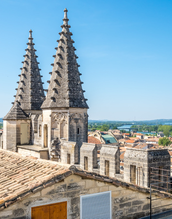 benedict: Architecture of roof top, tiles and sharp domes of Papal palace (Palais des Papes) under clear blue sky in Avignon, France