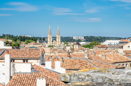 Cityscape view of Nimes in France, under cloudy blue sky