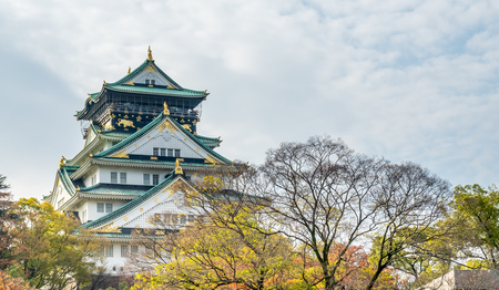 Osaka castle under cloudy blue sky in autumn season of Japan, landmark of Osaka city