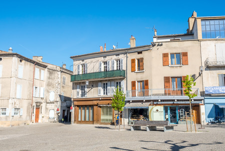 DIE, FRANCE - APRIL 13 : Buildings and shops at central square near church in Die town, France under clear blue sky, on April 13, 2017.