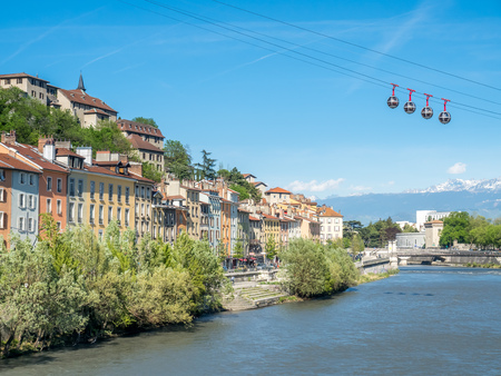 GRENOBLE, FRANCE - APRIL 13 : Grenoble-Bastille cable car, four bubbles on sling, transport to hill and fortress of Bastille cross Isere river in Grenoble, France, was taken on April 13, 2017.