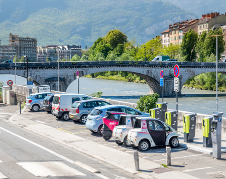 GRENOBLE, FRANCE - APRIL 13 : Electrical vehicles is charging battery at outdoor charging stations in Grenoble, France, on April 13, 2017. Editorial