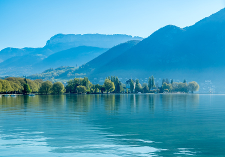 Lake and mountains in Annecy, France ,under morning clear blue sky Banco de Imagens
