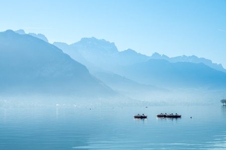 Lake and mountains in Annecy, France ,under morning clear blue sky 스톡 콘텐츠