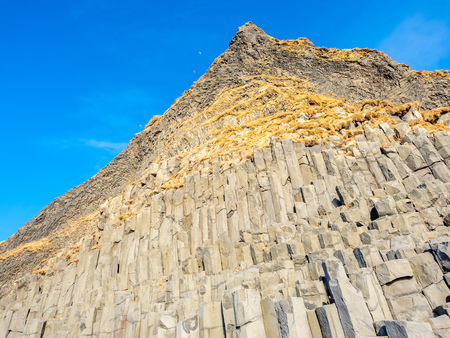Strange basalt rock mountain near Reynisfjara black sand beach in Vik town, one of the landmark of Iceland Stock Photo