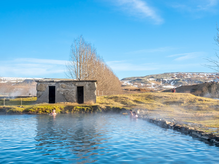 FLUDIR, ICELAND - MARCH 6 : Secret lagoon hot spring, public outdoor warming swimming pool, landmark of small city of Fludir, Iceland, was taken on March 6, 2018.