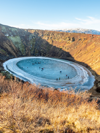 Kerid crater, huge quiet volcanic crater, in winter season become hard ice lake, in Iceland along golden circle road trip