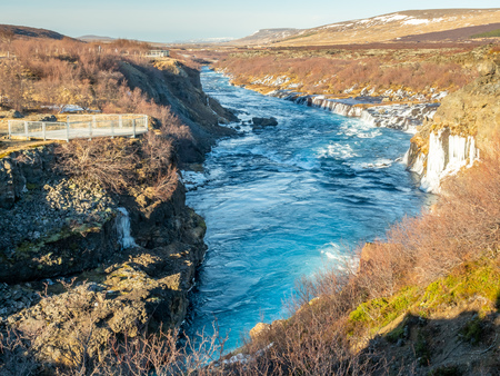 Surrounding view around Hraunfossar waterfall, unusual beautiful natural landmark in Iceland, during winter season