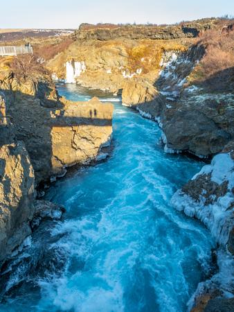 Surrounding view around Hraunfossar waterfall, unusual beautiful natural landmark in Iceland, during winter season
