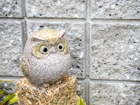 Small cute owl dolls decorated in outdoor Japanese style garden