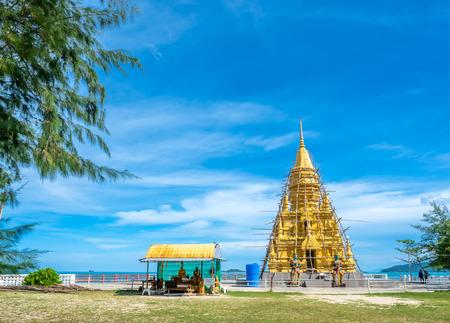 Phra That Laem Sor temple pagoda at sea side under cloudy blue sky in summer season, under construction at Samui island, Thailand