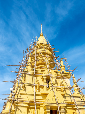 Phra That Laem Sor temple pagoda at sea side under cloudy blue sky in summer season, under construction at Samui island, Thailand