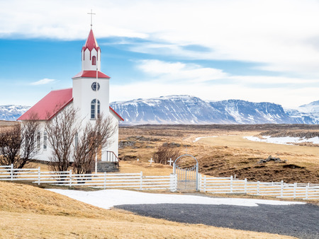 Helgafell church, classic architecture building of iceland church, on hill in winter season under cloudy blue sky